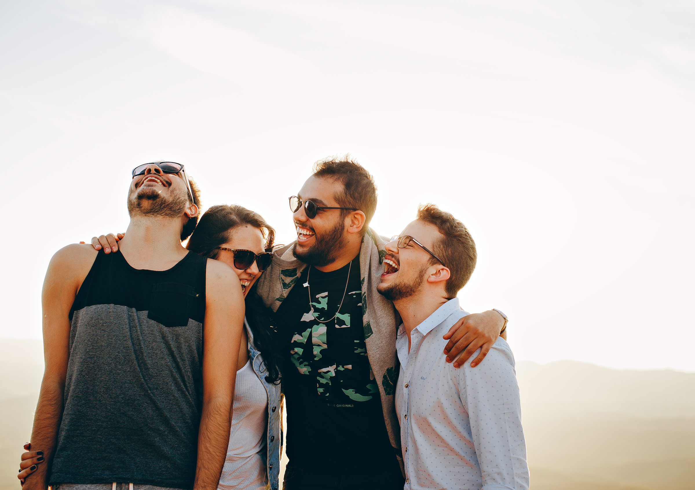 friends laughing together on a white background